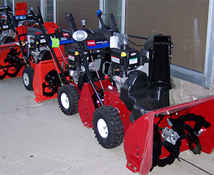 A row of red Toro snowthrowers