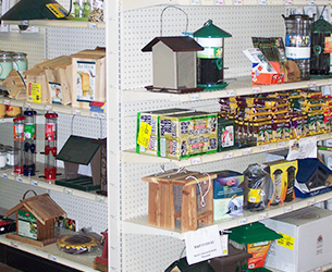 Store shelves with bird houses, bird feeders, and suet cages
